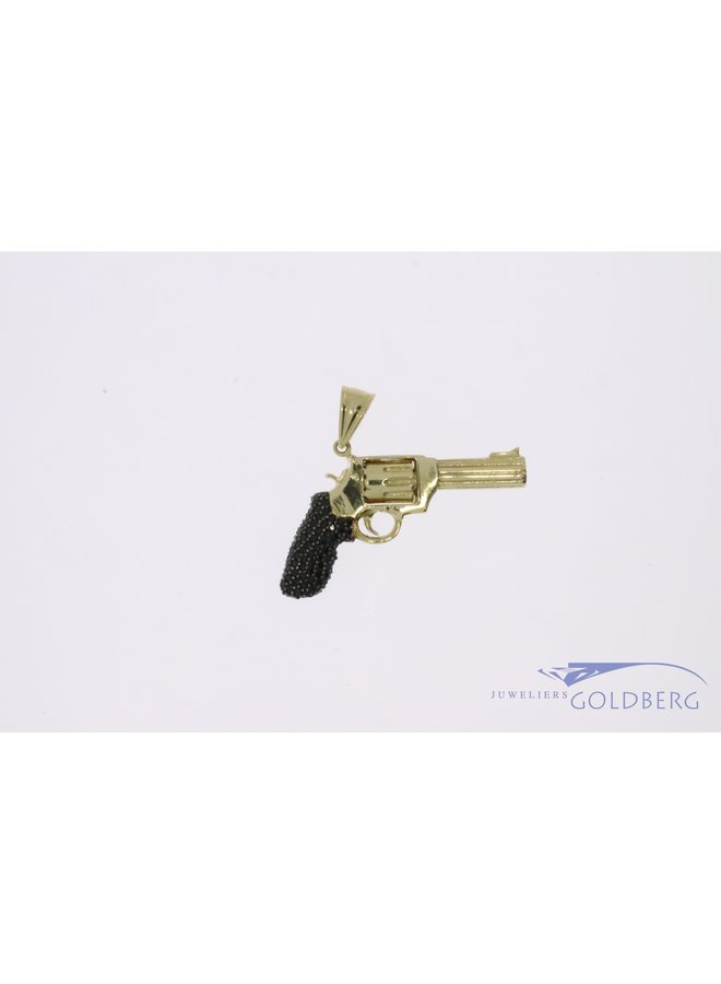 14k gold revolver pendant with rotating cylinder and black zirconia's