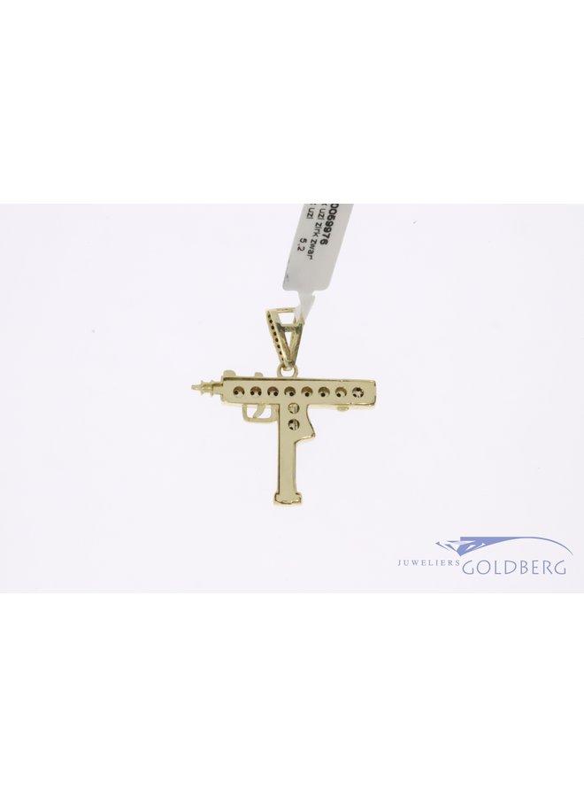 """14k gold """"Uzi"""" pendant with black zirconia's"""