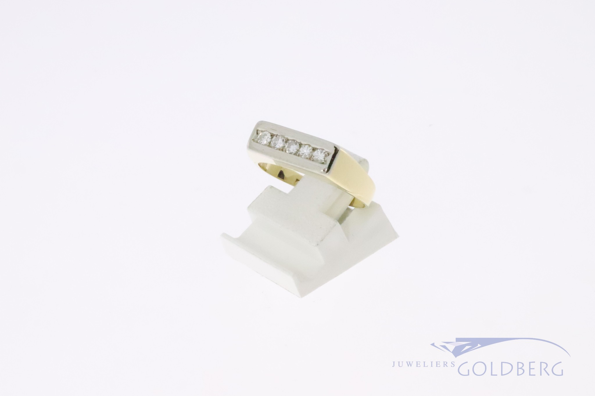14k yellow gold ring with five diamonds in a white gold setting.
