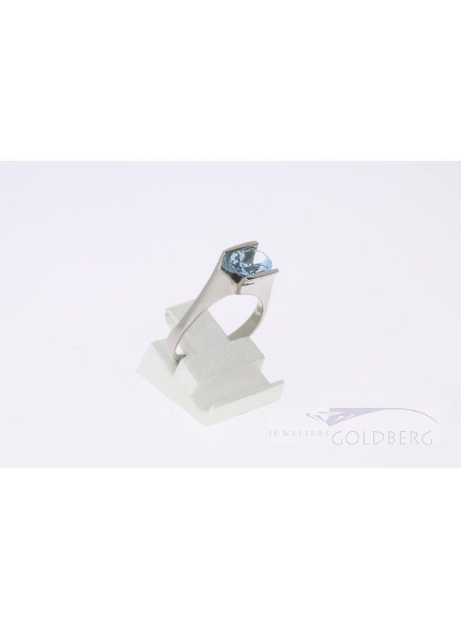 Modern 14k white gold ring with blue topaz