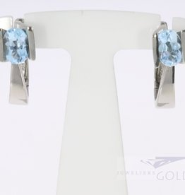 Modern 14k white gold earrings with topaz