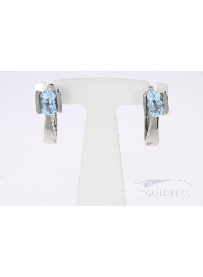 Modern 14k white gold earrings with blue topaz