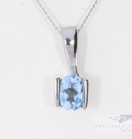 Modern 14k white gold pendant with topaz