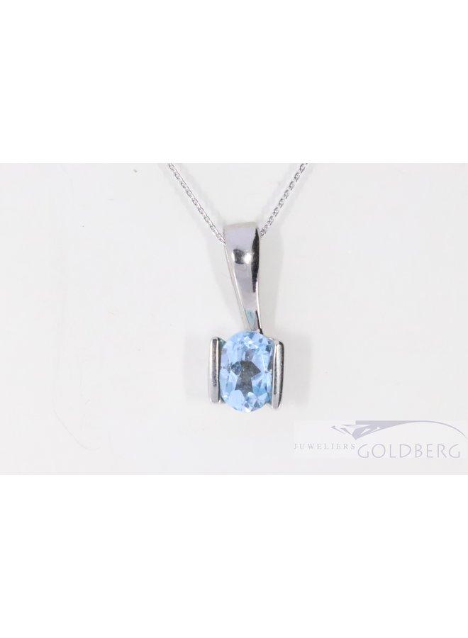 Modern 14k white gold pendant with blue topaz
