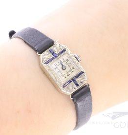 Subtiele art deco dames horloge met diamant en saffier.