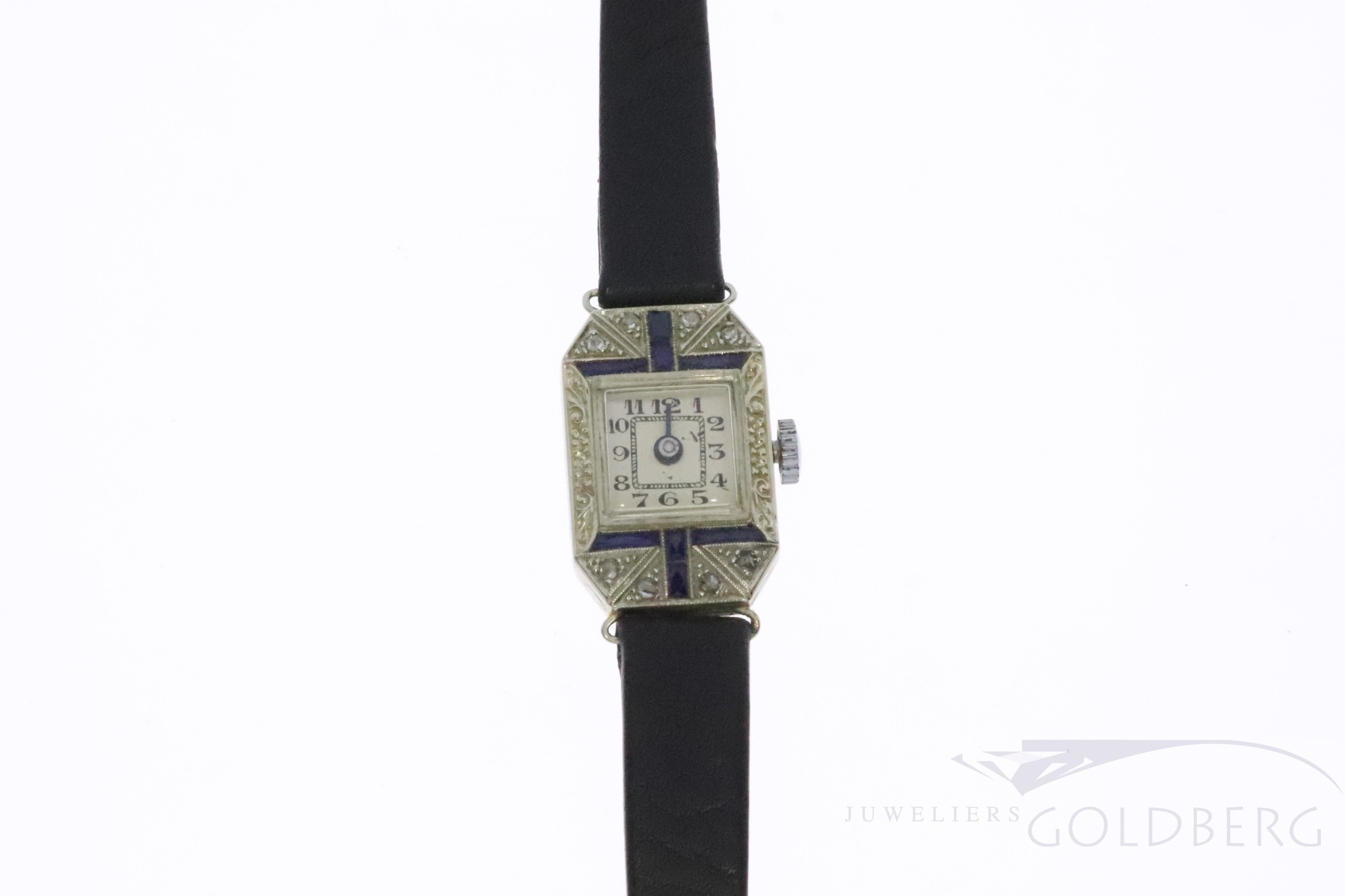 Subtle art deco ladies watch with diamond and sapphire.