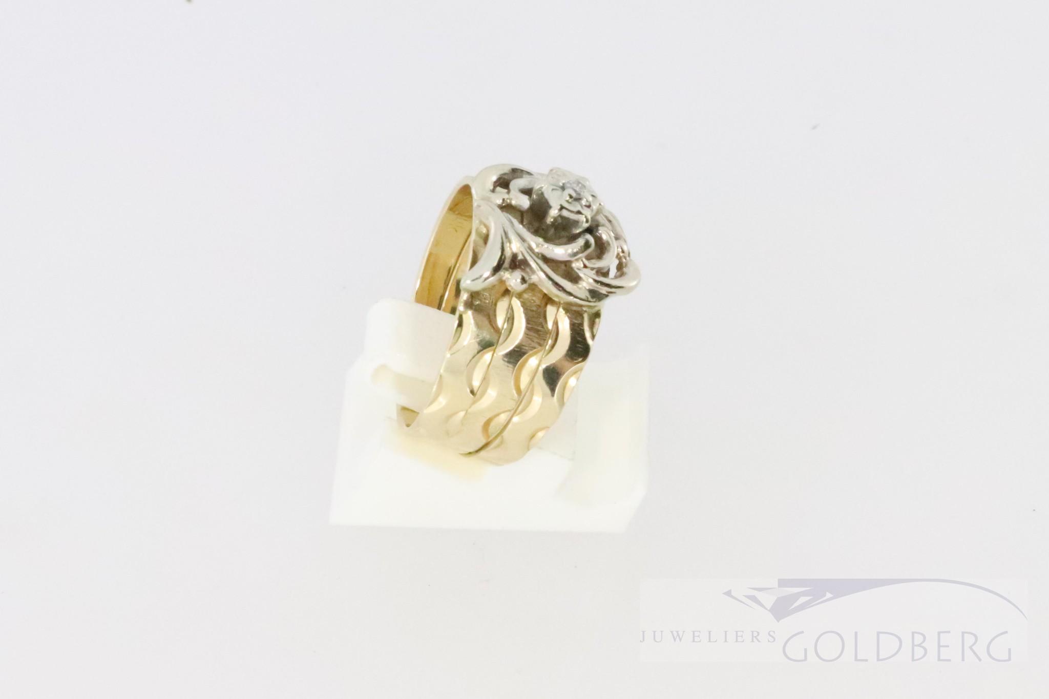 Brede 14k bi-color gouden ring met een diamant