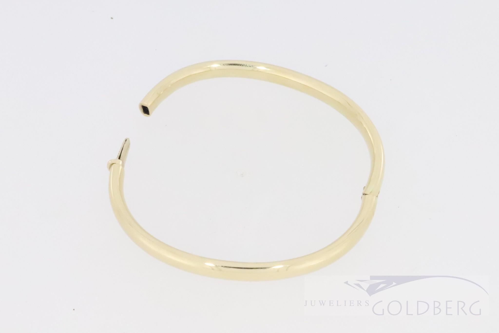 stylish 14k yellow gold slave bangle