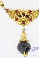 14k gold necklace with filigree and garnet