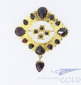 antique 18k gold pendant with garnish