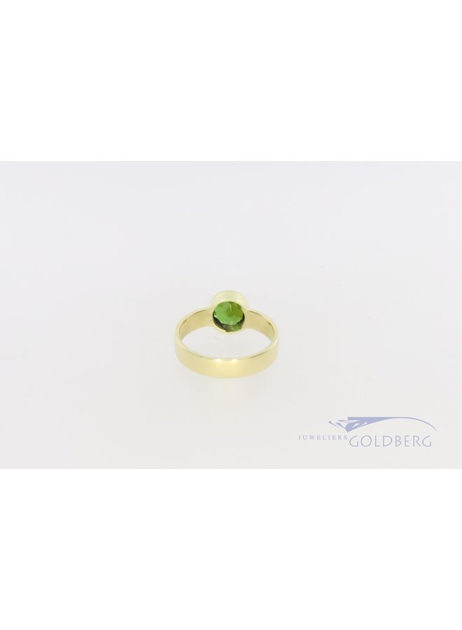 14k gold ring with diopsite from our own workshop
