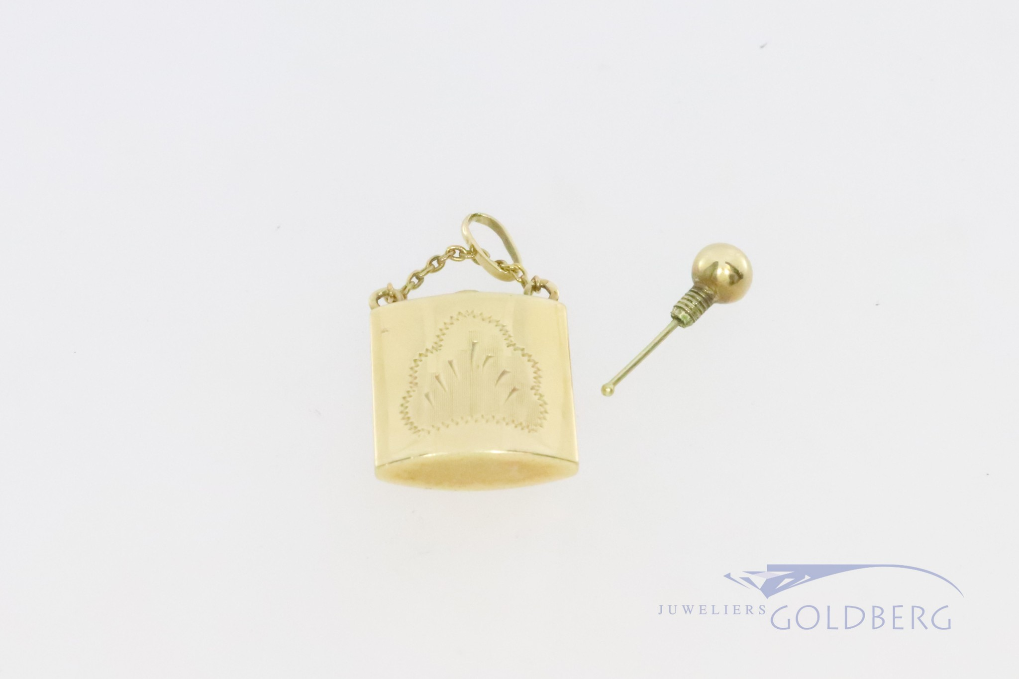 14k pendant from a perfume bottle