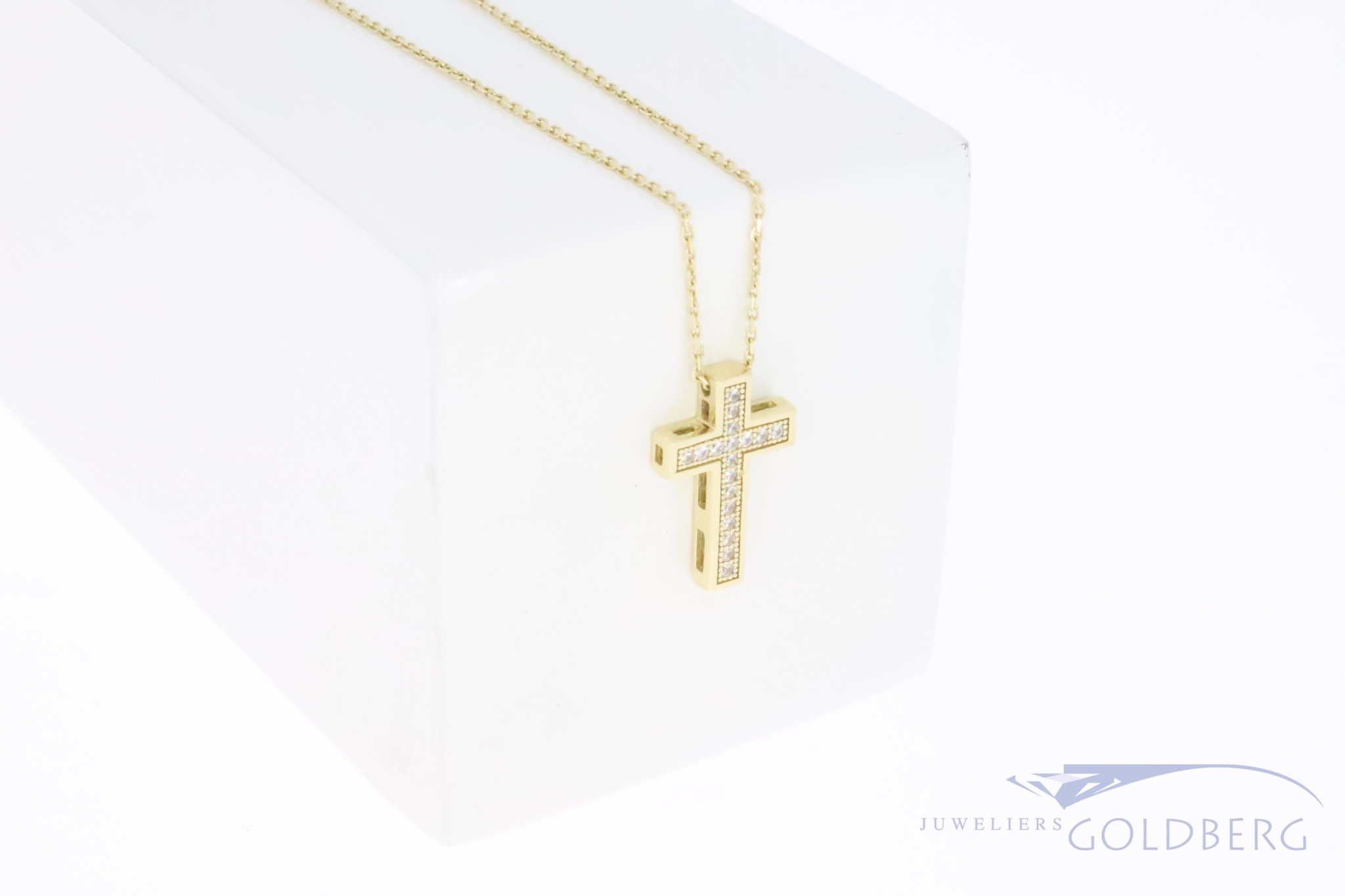 14k yellow gold cross with zirconia's on necklace