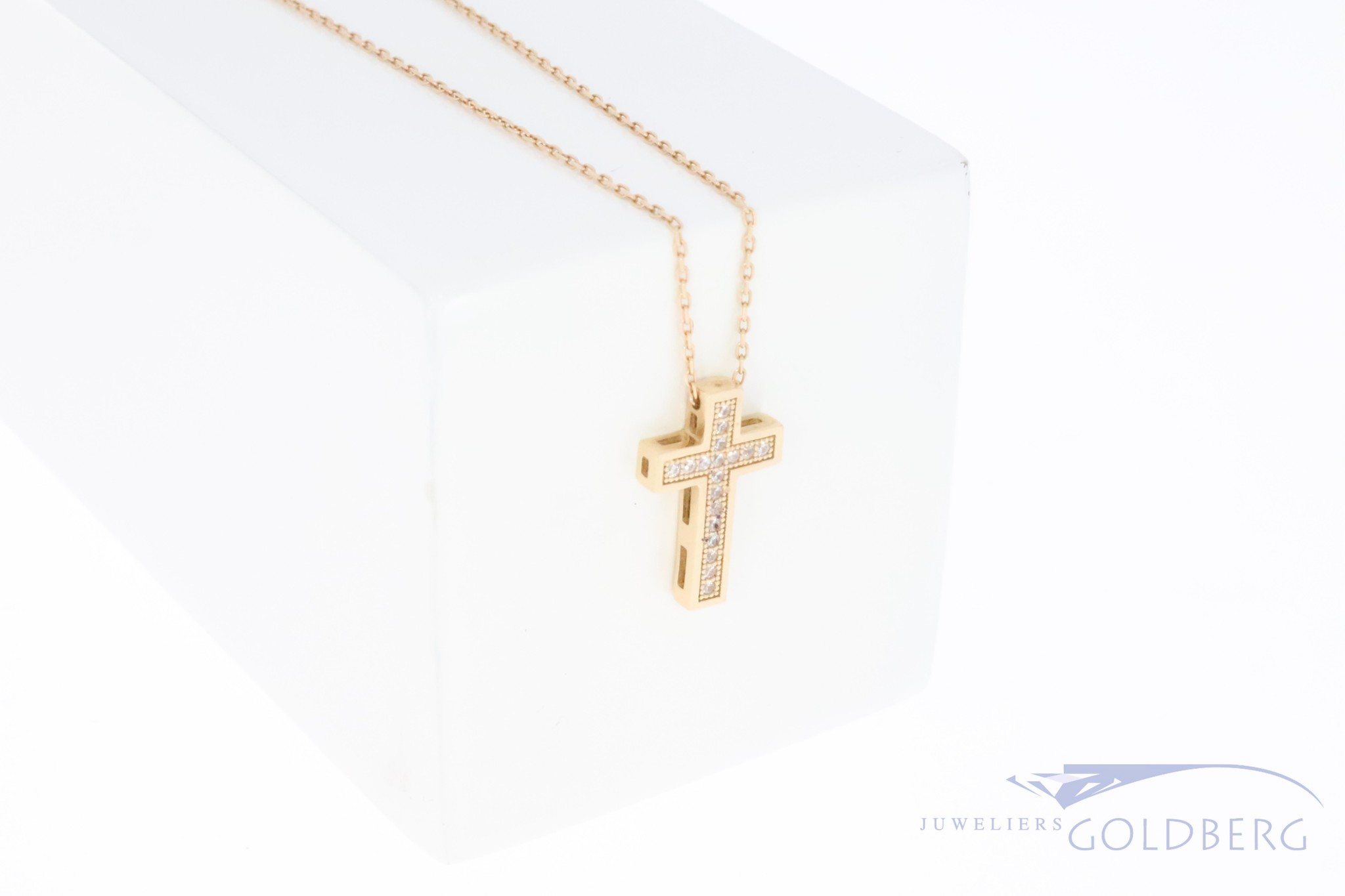14k red/rose gold cross with zirconia's on necklace