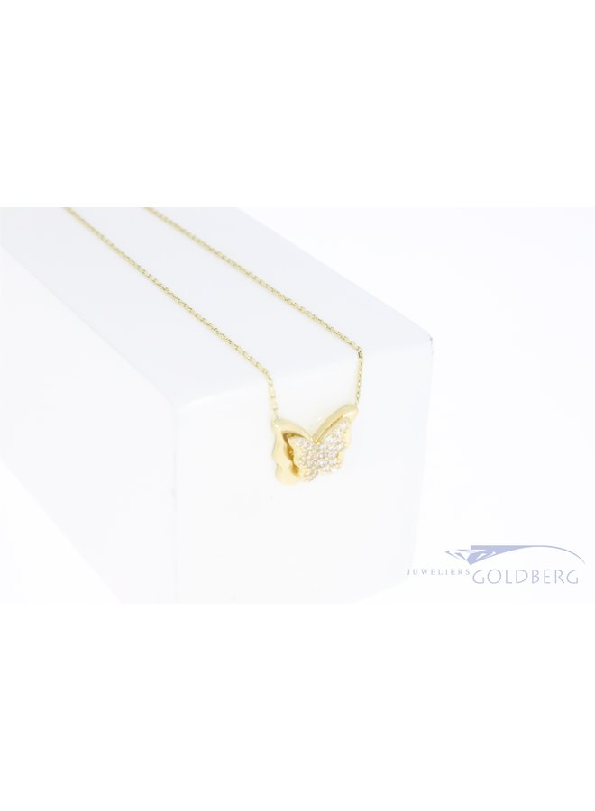 14k gold butterfly pendant with zirconia on necklace