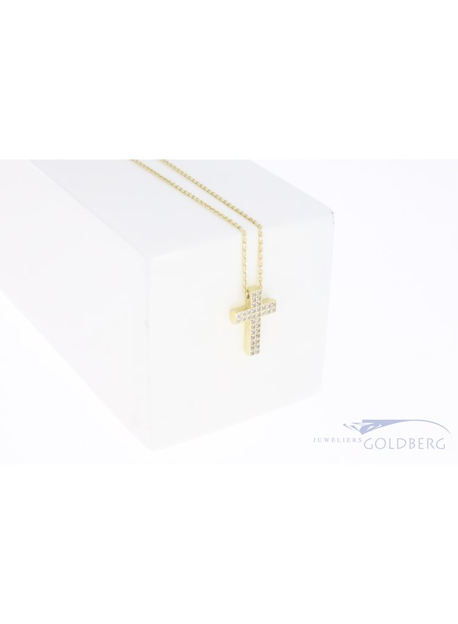 Small 14k gold cross with double row of zirconia's on a necklace