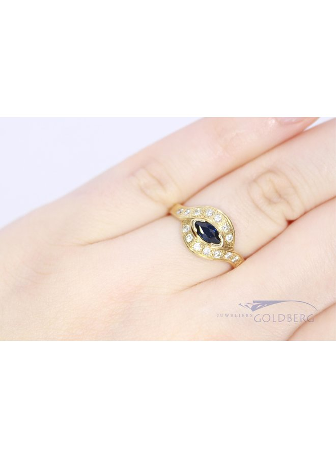vintage 14k ring with diamond and sapphire.