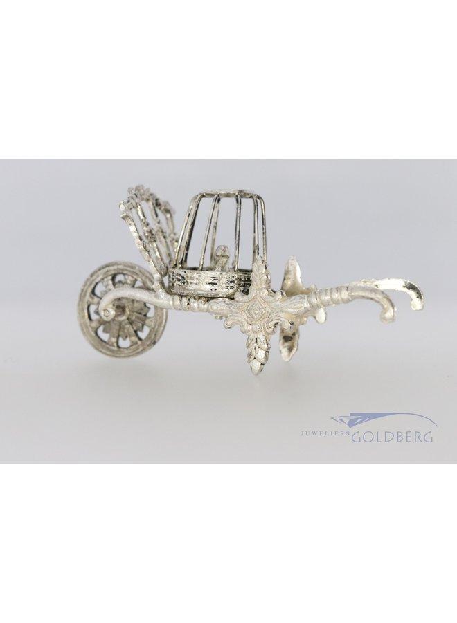 miniatuur krulwagen met eenden uit 1975.