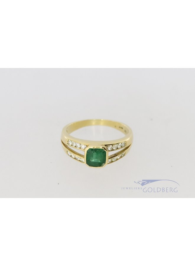 18 carat gold ring with diamond and emerald