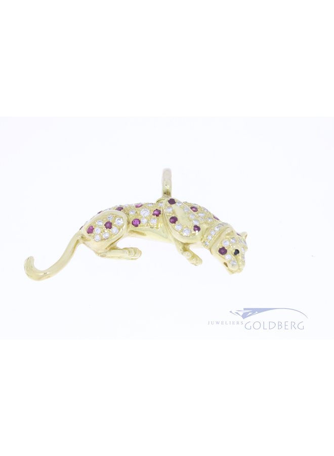 18k jaguar pendant with diamond and ruby.