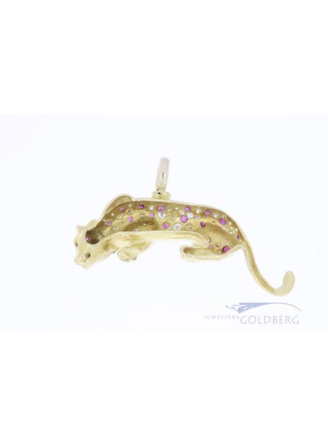 18k jaguar pendant with diamond and ruby.