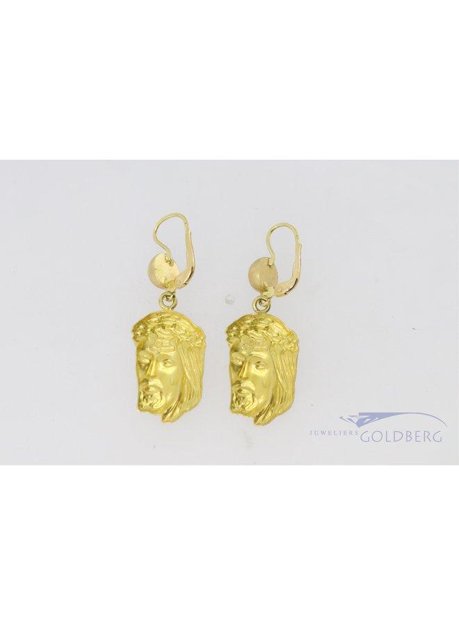 18k gold Jesus earrings.