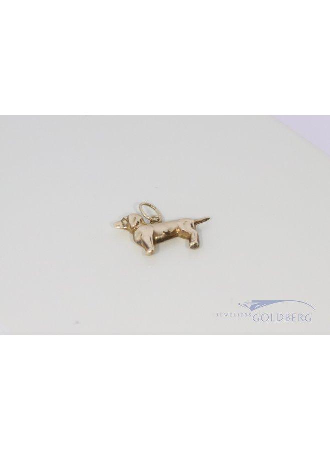 14k yellow gold dachshund pendant.