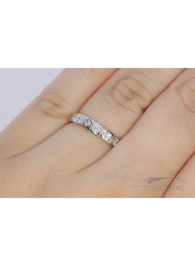 18k white gold alliance ring with diamond.