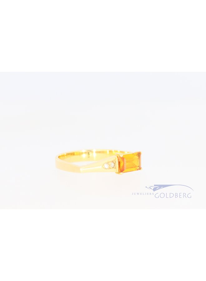 modern 18 carat ring with citrine and diamond