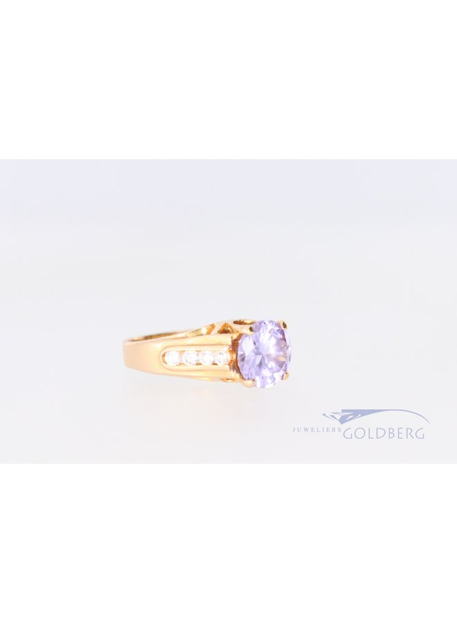 18k ring with zirconia and amethyst.