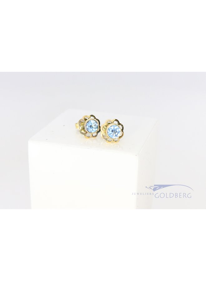 yellow gold 14k earrings with aquamarine colored spinel.