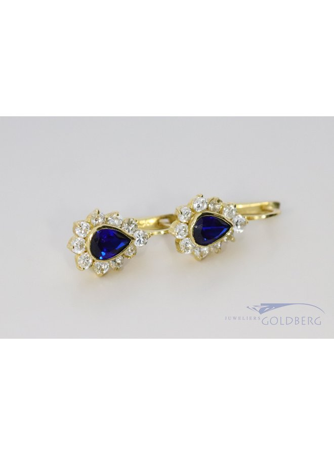 14k gold earrings with blue and white zirconia
