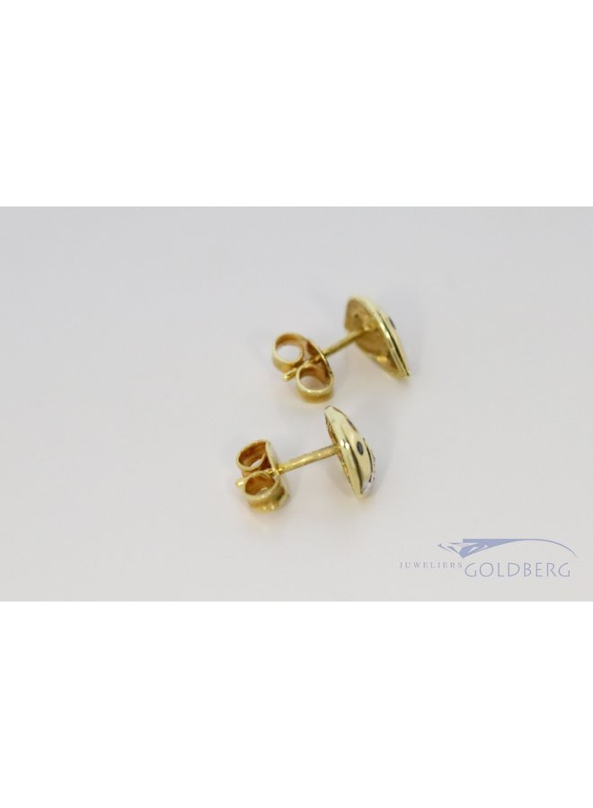14k gold fantasy earrings with diamond, ruby and sapphire.