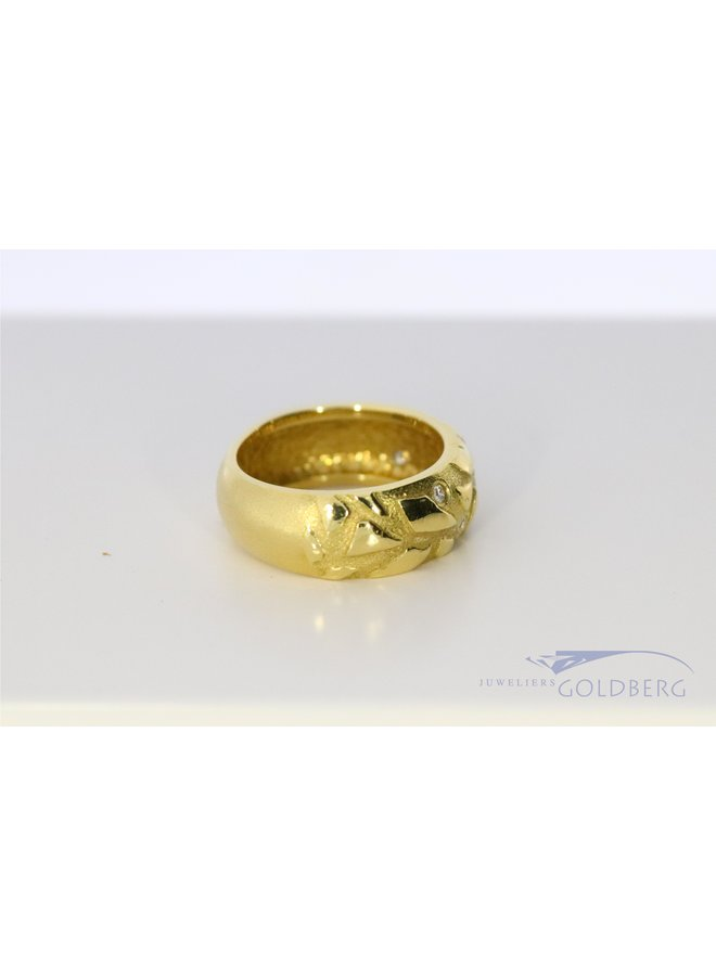wide modern 18k ring with diamond