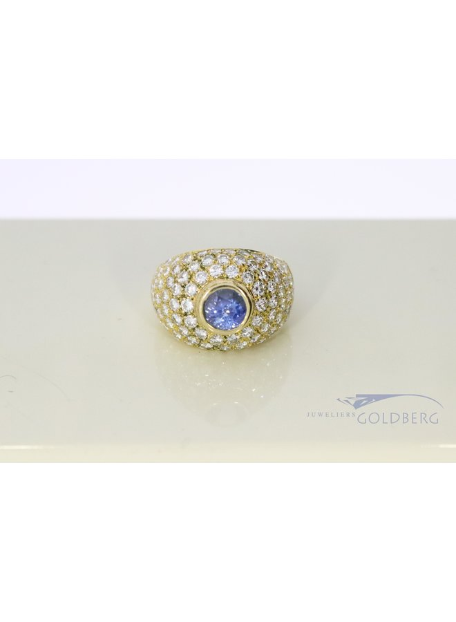 18k wide ring with blue tourmaline and diamond