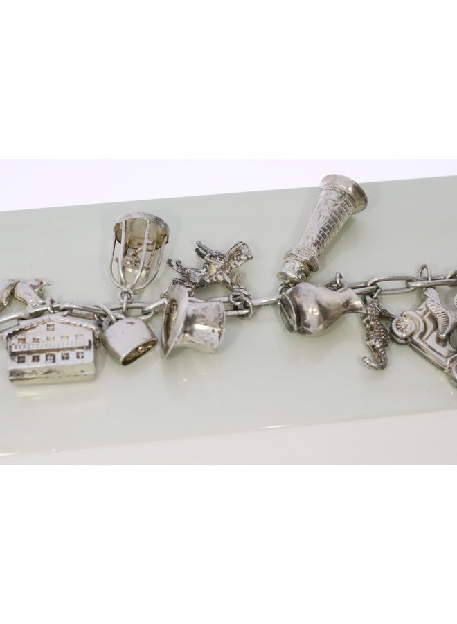 .835 Silver CFE bracelet with 14 charms.