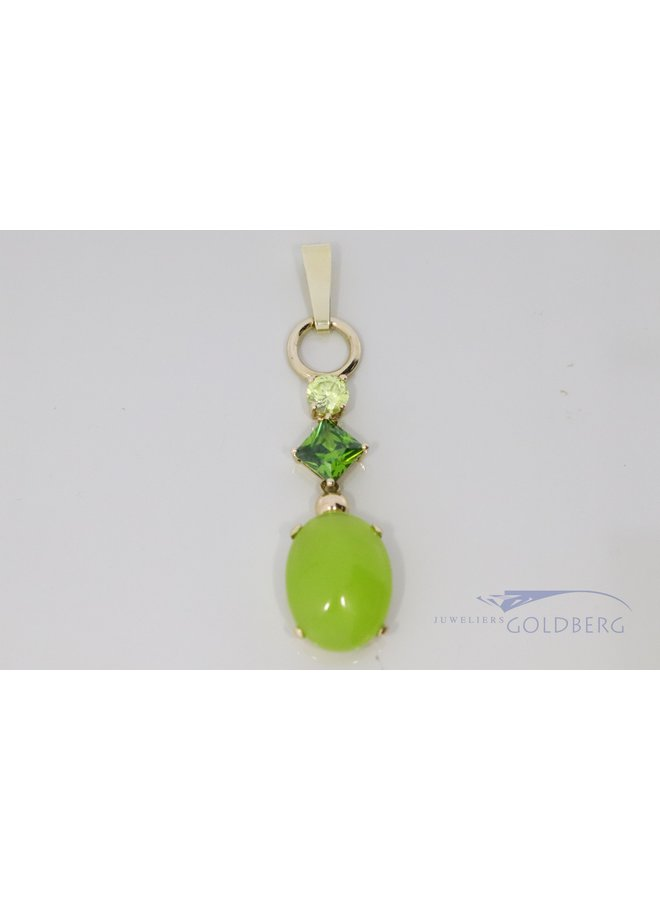14k gold pendant with green stones