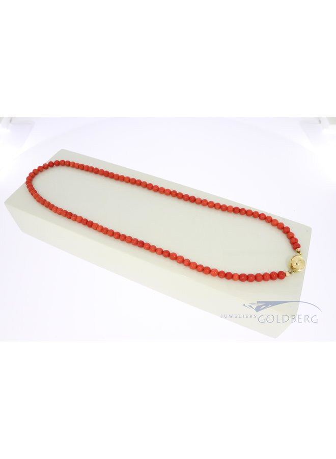 red coral necklace with 14k gold clasp.