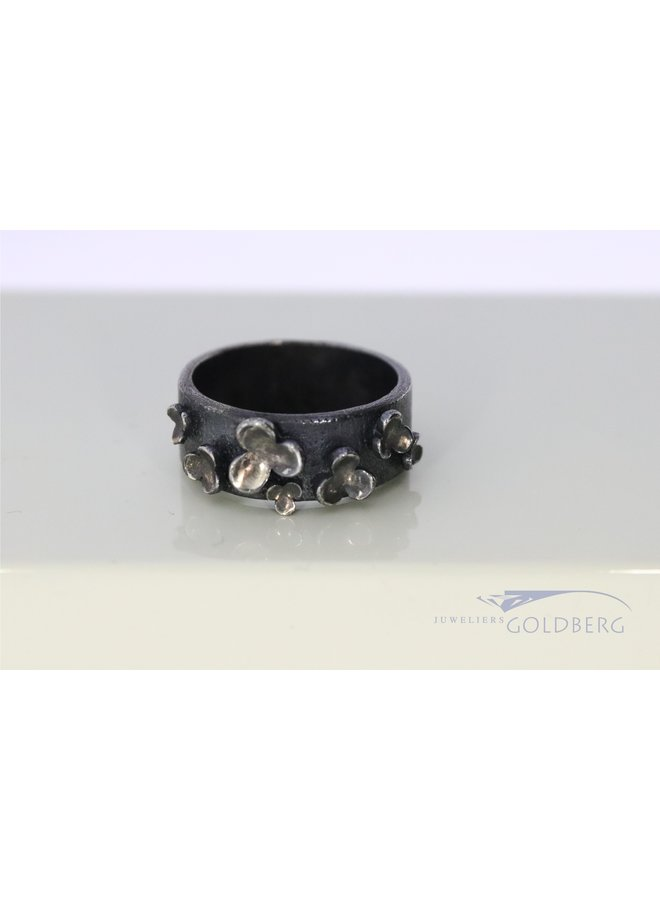 Rabinovich oxidized silver ring with flowers.