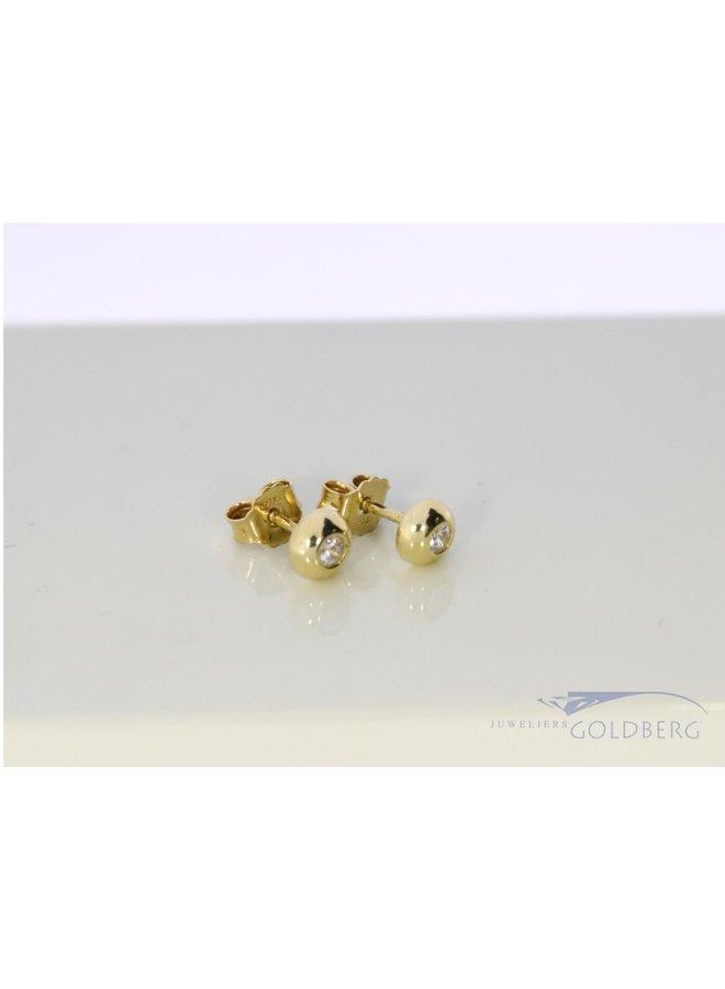 14k  earrings with zirconia.