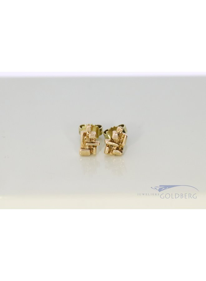 modern ear studs in 14k yellow gold.