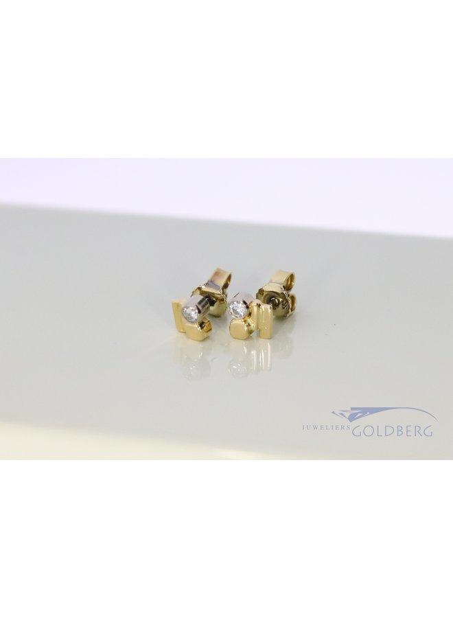 14k bi-color modern ear studs with diamond.