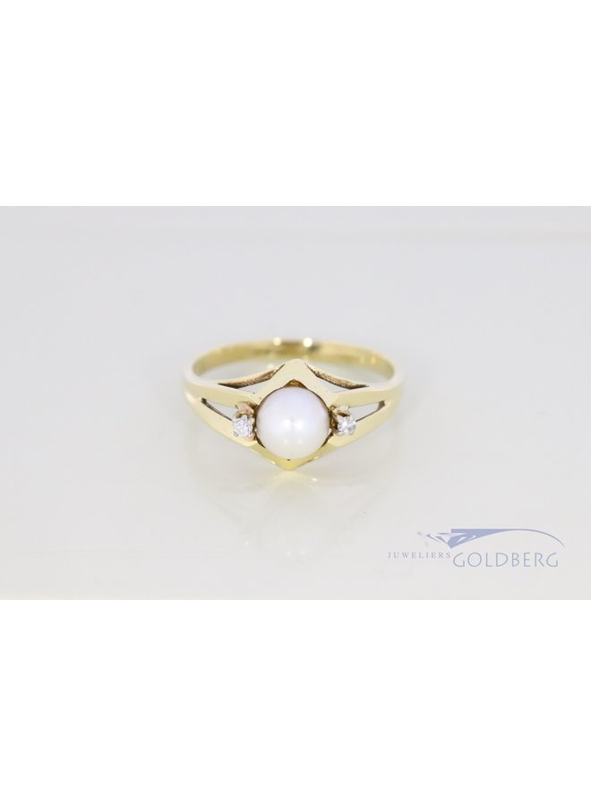14 carat gold vintage pearl ring with diamond