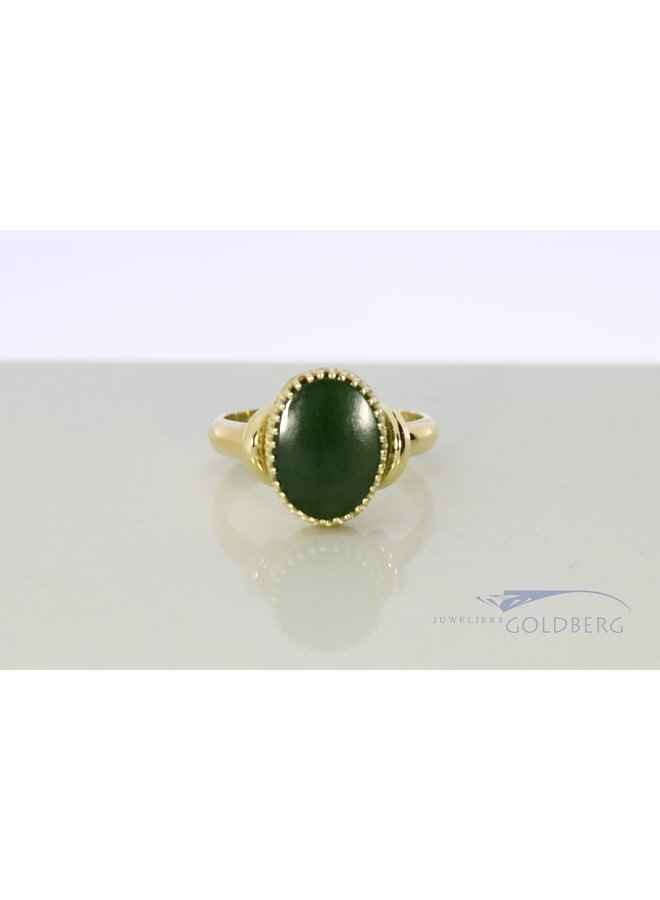 14 kt gold ring with jadeite from our own studio.