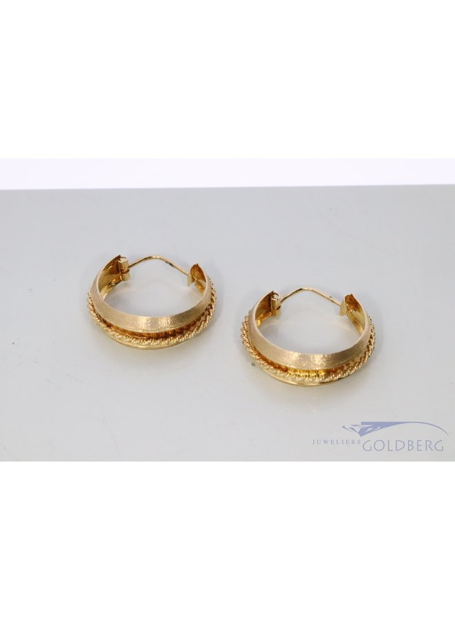 14k gold hoop earrings with rope chain.