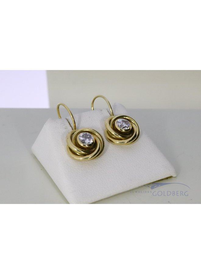 14k gold earrings with zirconia.