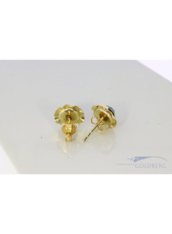 14k vintage garnet stud earrings with wavy rims.