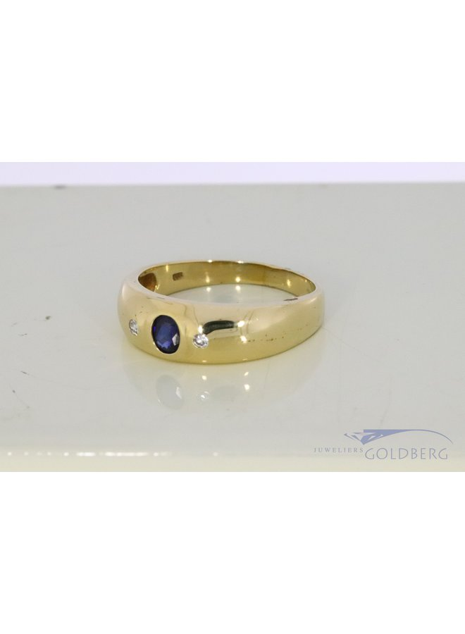 broad 14k gold ring with sapphire and diamond