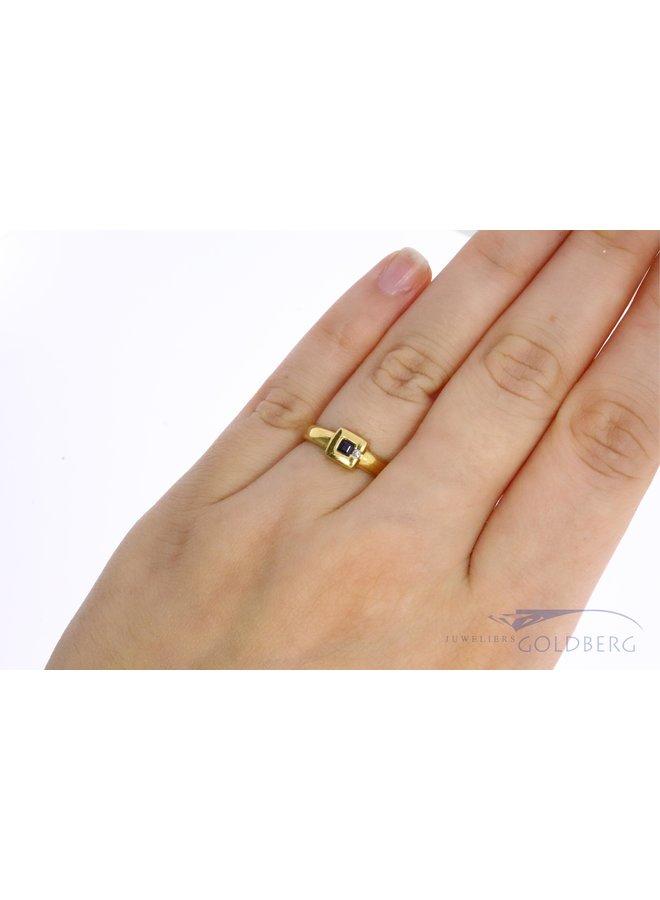 18k ring with princess cut sapphire and diamond.