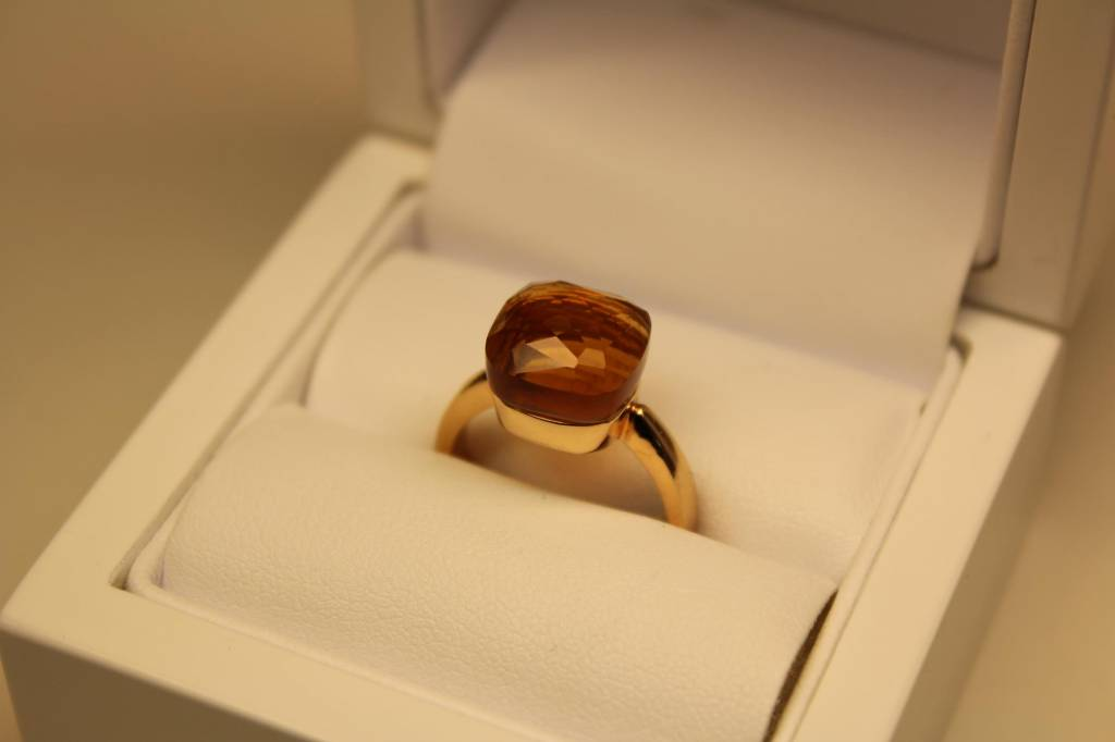 18 carat rose gold ring with facet cut orange stone